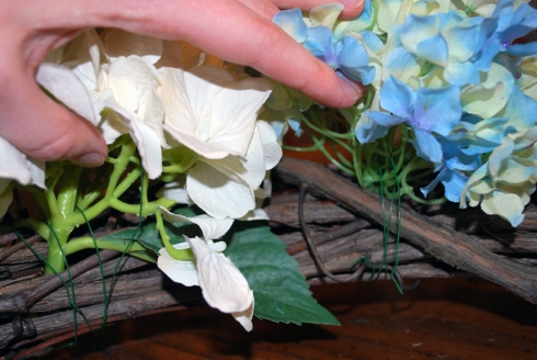 Attaching flower to wreath